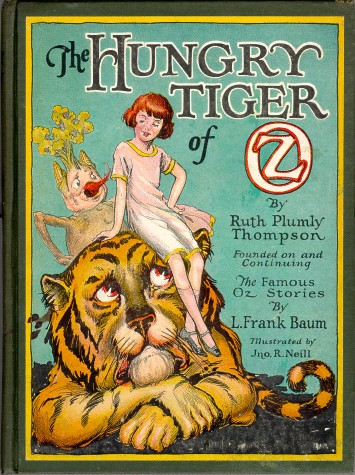 An illustration for the story The Cowardly Lion and the Hungry Tiger by the author L. Frank Baum